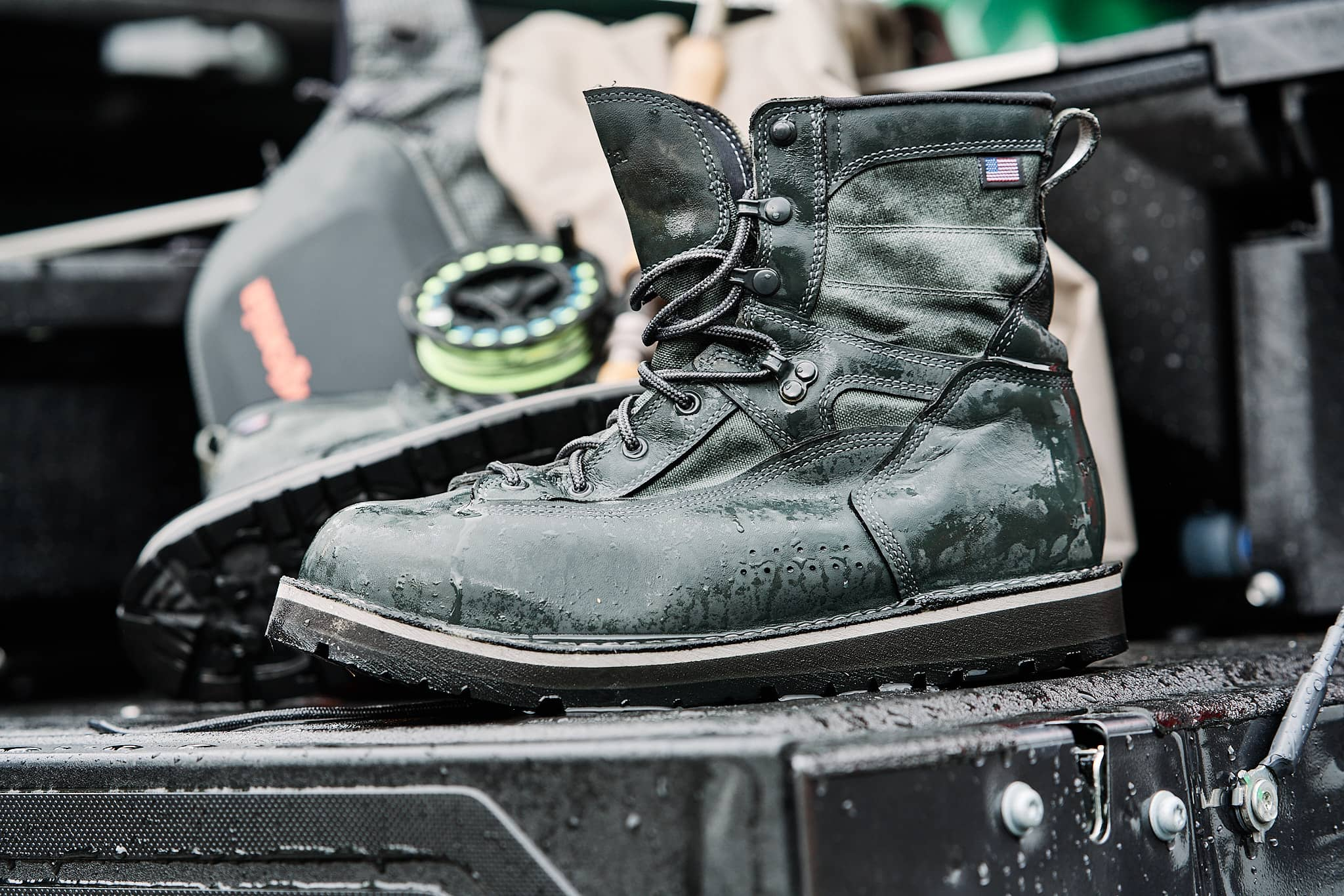 Side view of wet wading boots sitting on a truck tailgate