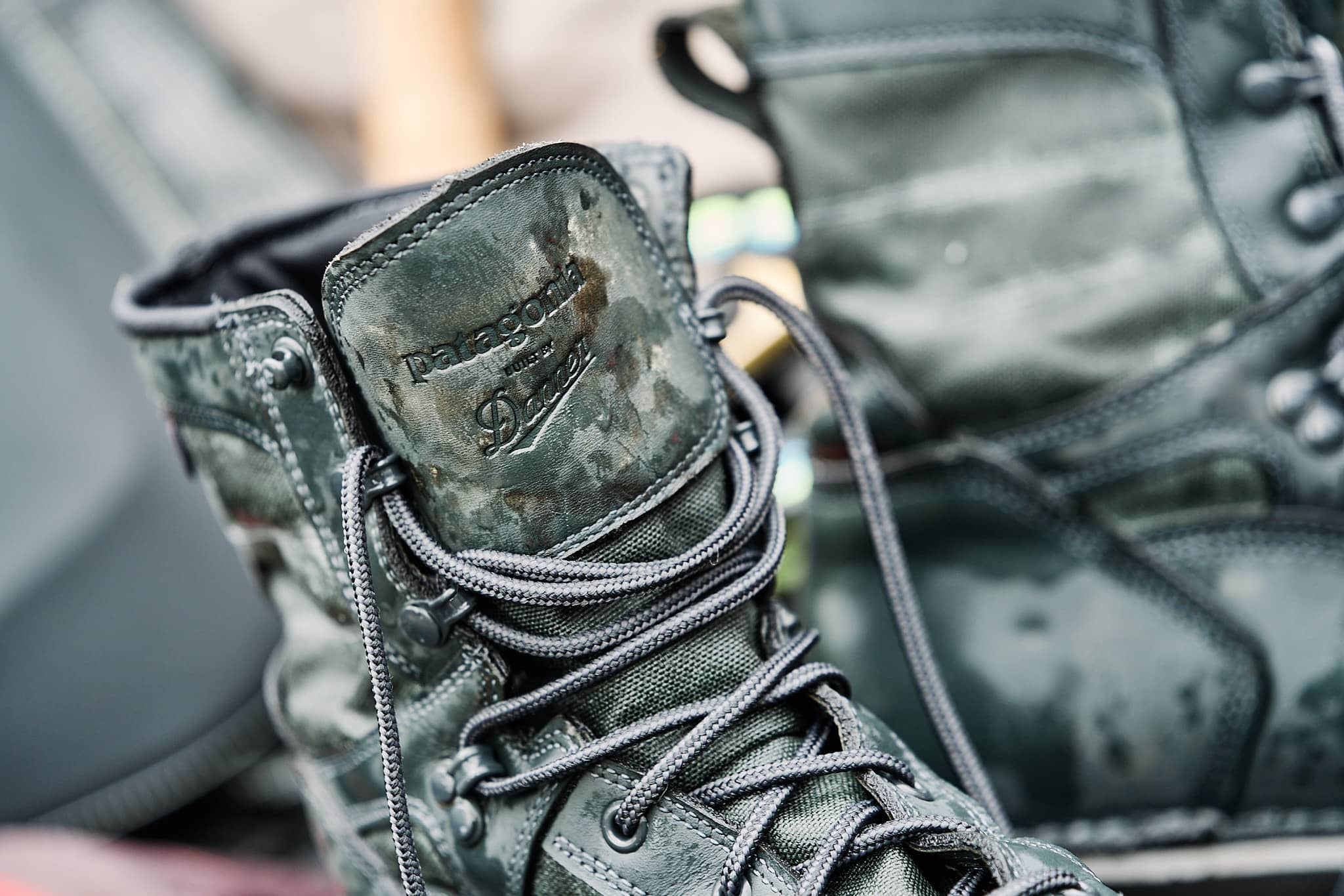 Closeup view of the Patagonia and Danner logos on the tongue of the wading boots
