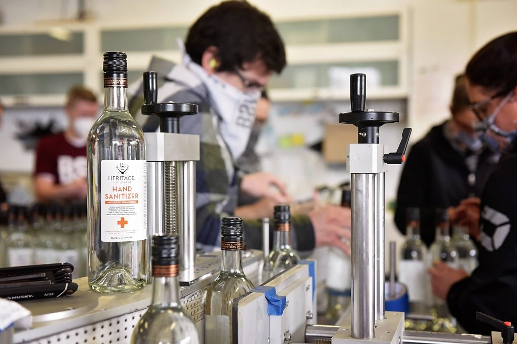 Heritage Distilling staff working to make sanitizer available for purchase