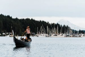 The Gig Harbor Gondola carrying passengers with Mt. Rainier in the background.