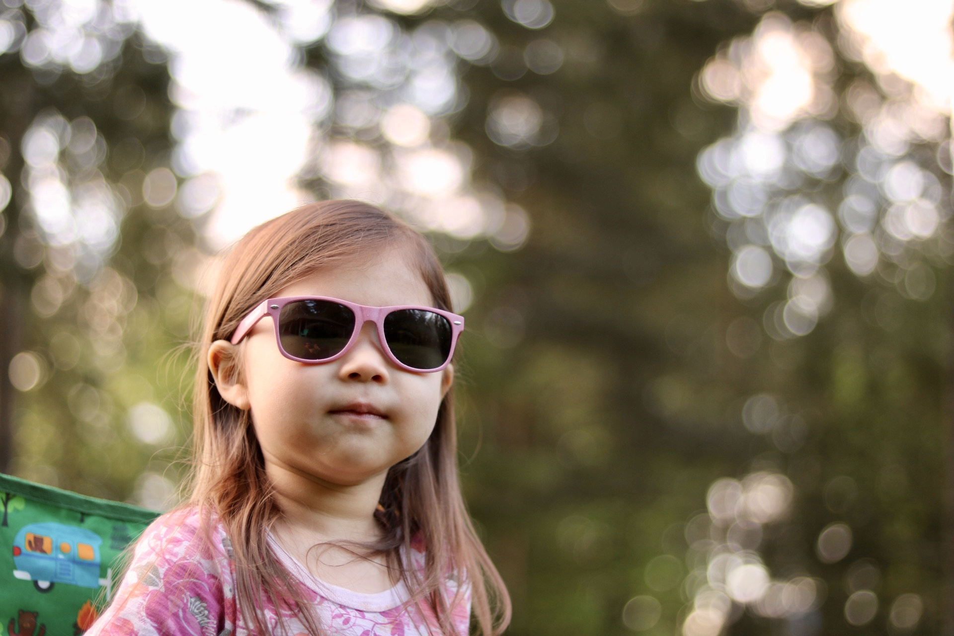 Front view of the the kids' pink BioSunnies on a toddler