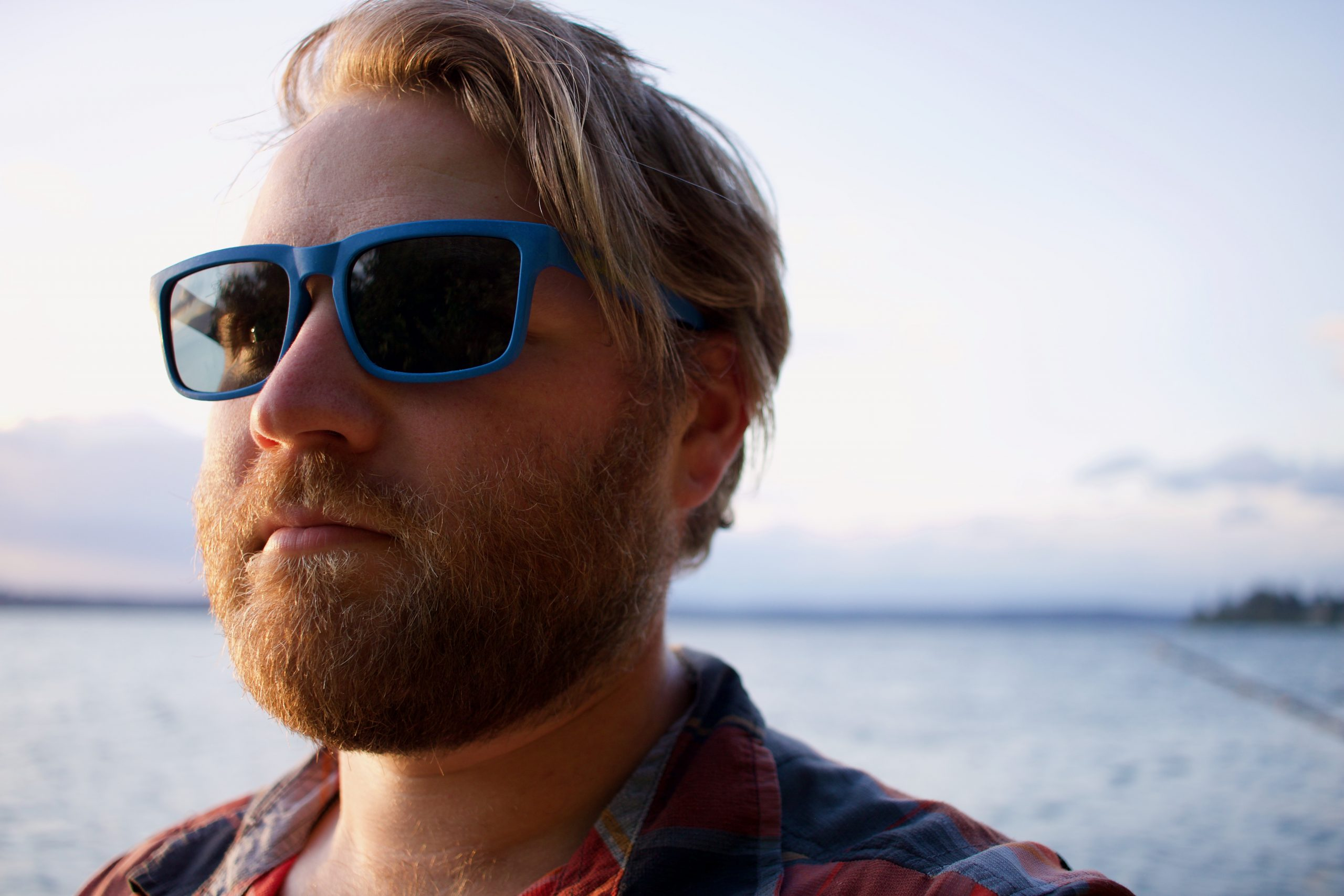 A man wearing the BioSunnies Freedoms near the water
