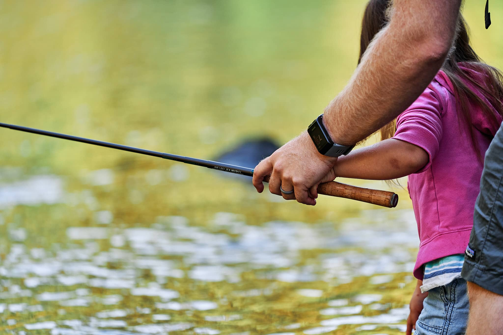 Dad and daughter gripping a Tenkara rod