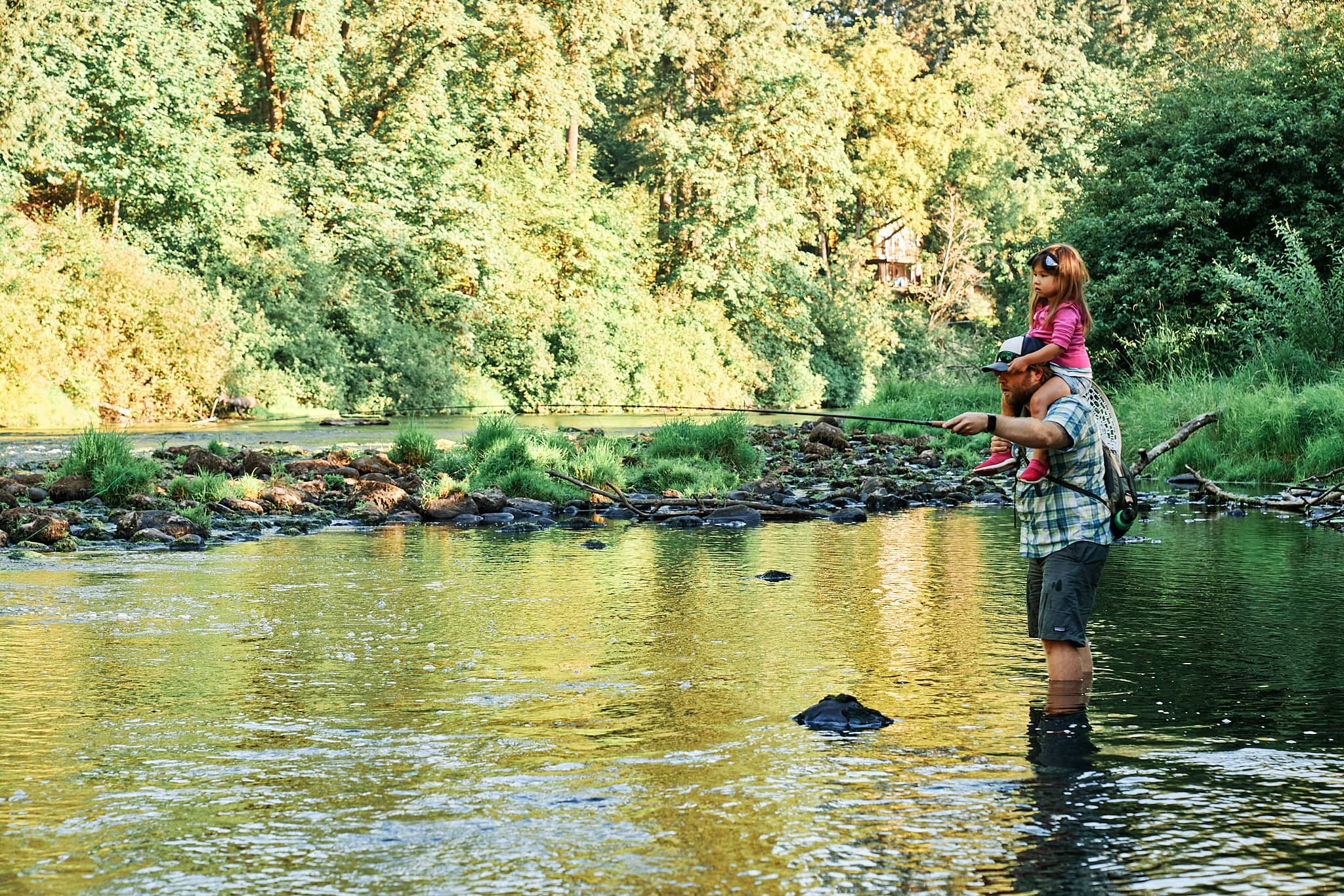 McKenzie fishing with her Dad on the river