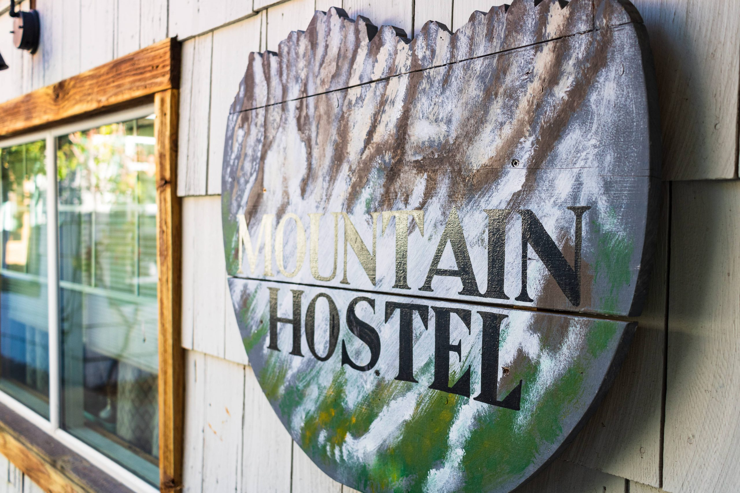Sign that reads Mountain Hostel on an exterior wall of the North Cascades Mountain Hostel