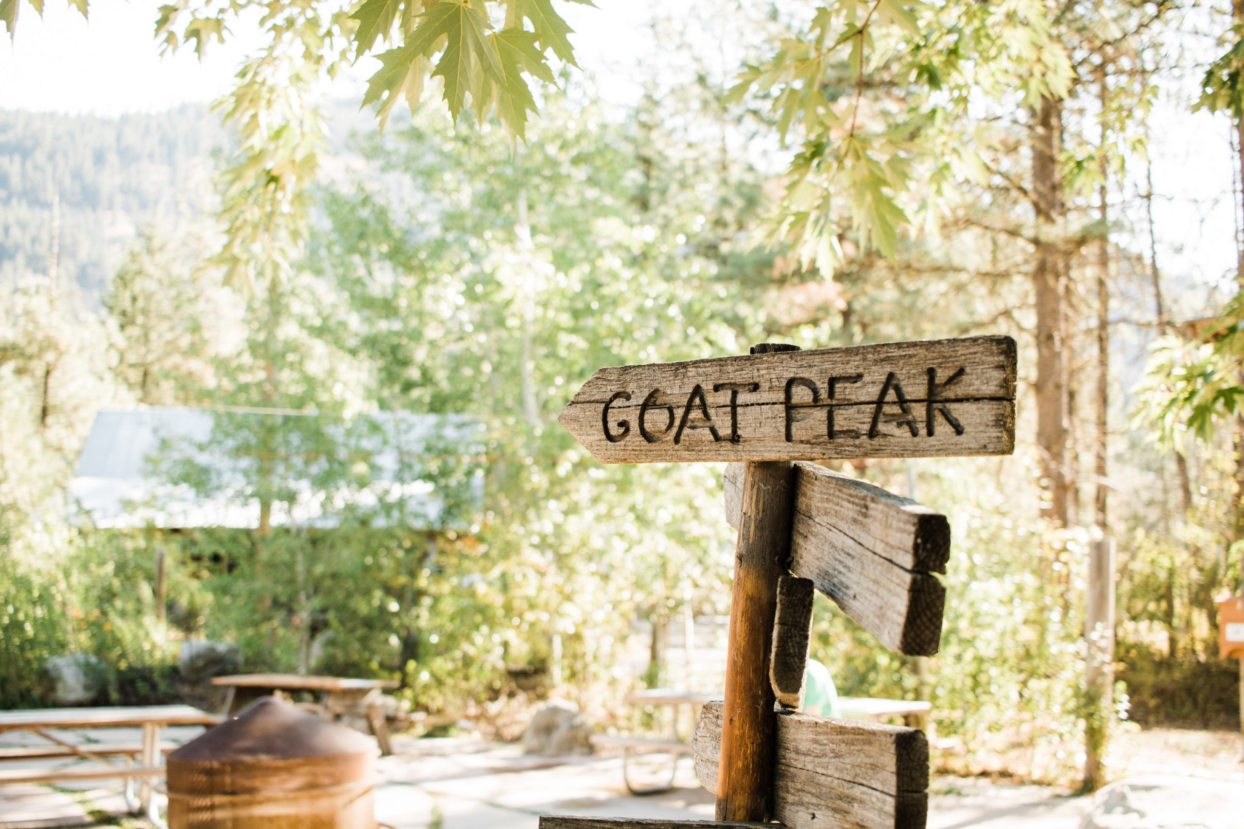 """Sign that reads """"Goat Peak"""" in the courtyard of the Mazama Store"""