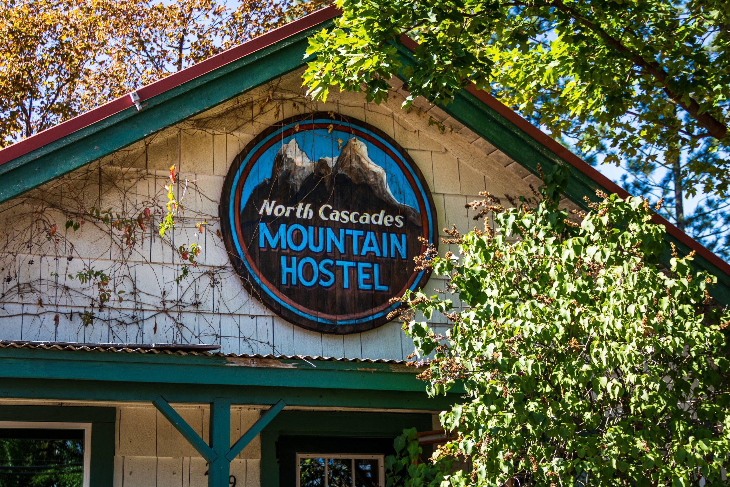 The North Cascades Mountain Hostel sign on the front of the house